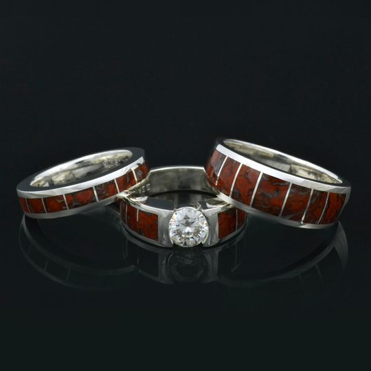 Dinosaur bone wedding ring set featuring a brilliant round moissanite in the engagement ring.  All...