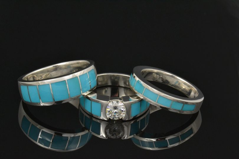 Turquoise wedding ring set featuring a brilliant round moissanite in the engagement ring.  All the...