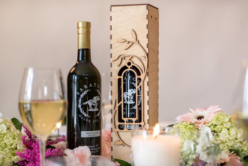 750ml (wine size bottle) plus elegant wooden box. Great gift for your wedding party or anyone who...
