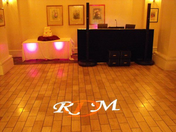 Wedding reception with small uplighting and monogram projection.