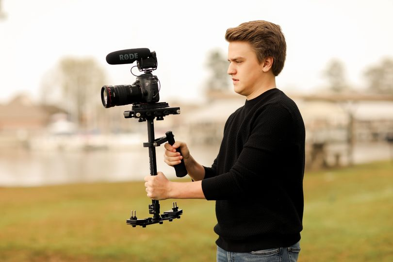 Videographer with camera