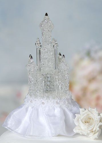 This beautiful wedding cake topper features an artisan made blown glass castle accented with 24K...