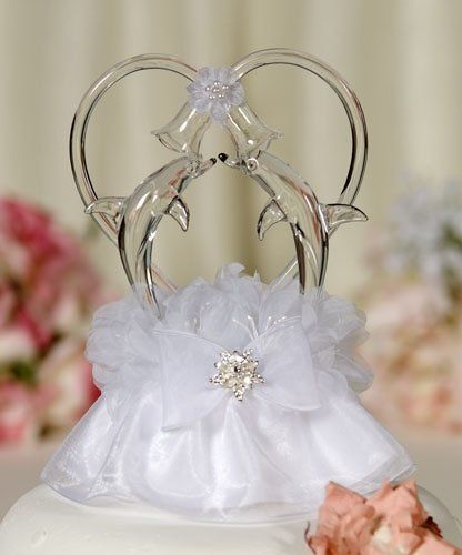 This beautiful wedding cake topper features a pair of artisan made blown glass dolphins accented...