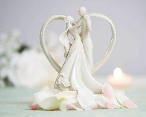 This Stylized Bride and Groom with Heart Frame Figurine is a contemporary twist on a traditional...