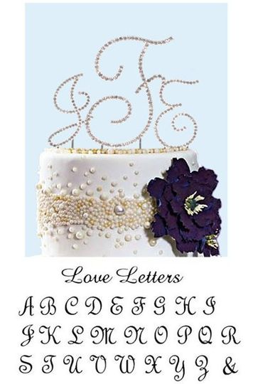 This striking full crystal initial monogram wedding cake topper features elegant script and delicate...