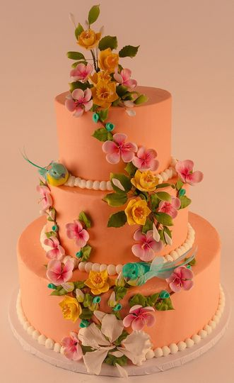 Sugar flowers ascending the cake