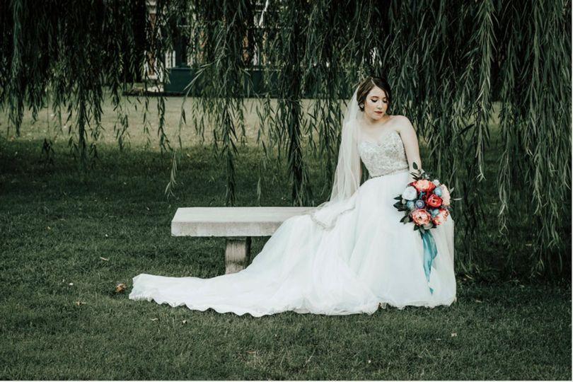 A bride under on a garden bench