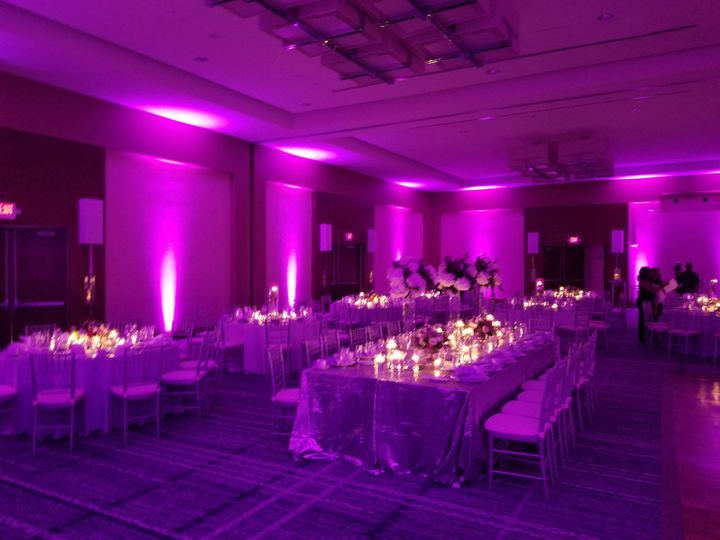 Candlelit tables and pink uplights