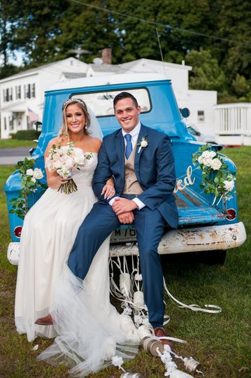 Vintage blue truck and fresh white roses