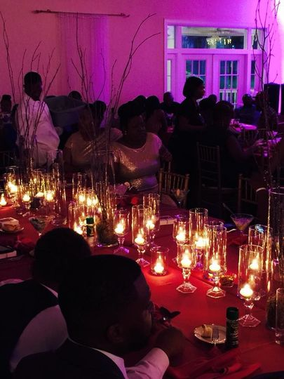 A reception lit by candles