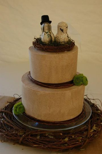Two tiered wedding cake.  Bottom tier: Chai cake with cardamom frosting.  Top Tier: Lemon Cake with...