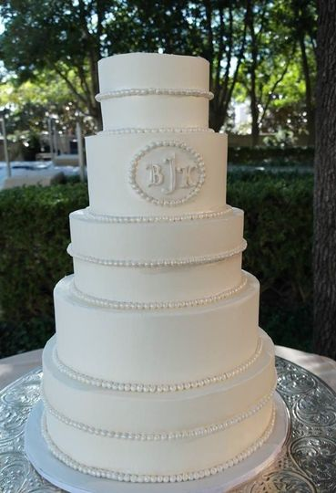 White cake with embossed logo