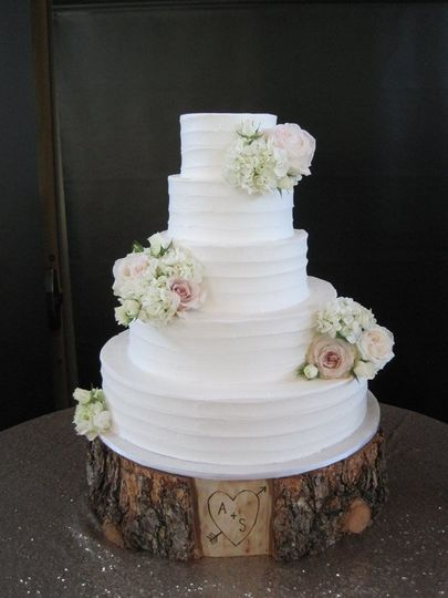 White cake with white roses