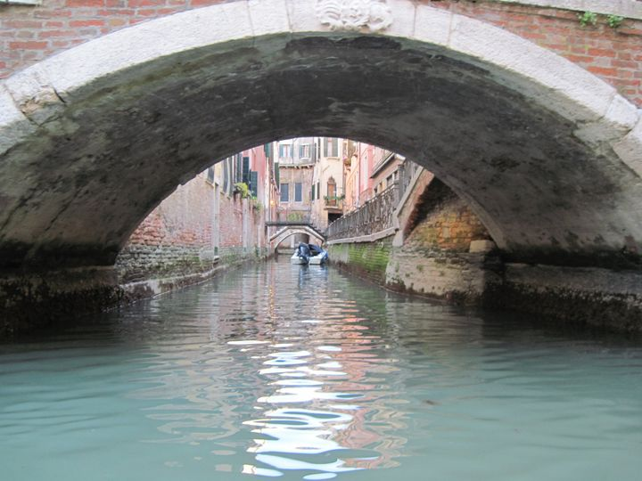 Going down the canals in Venice
