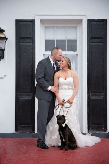 Bride & Groom with their dog at Brierwood Country Club. Image by Lovely Day Photo