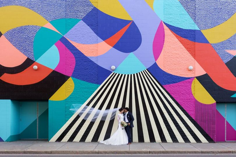 Wedding couple Standing in from of mural in Buffalo New York, Photo taken by Lovely Day Photo