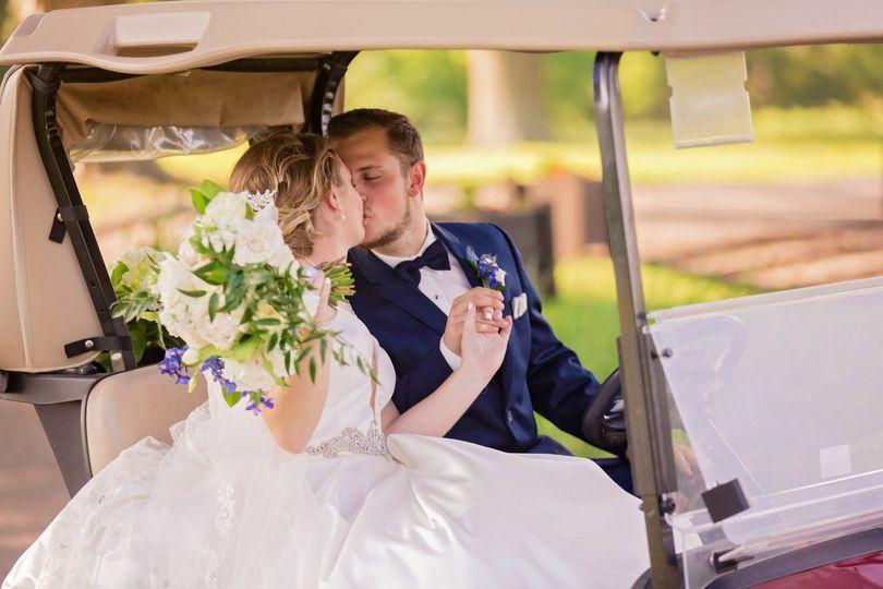 Bride & Groom Kissing on Cart