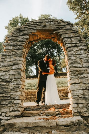 Kissing Under Stone Archway