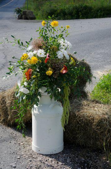 Delightful milk can vase