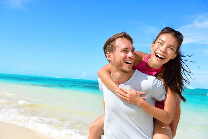 bigstock happy couple in love on beach 85188443