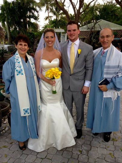 Newlyweds with the officiants