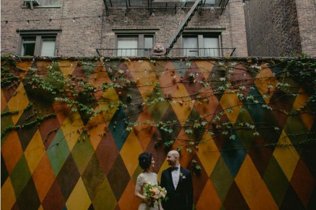 Newlyweds by the mural