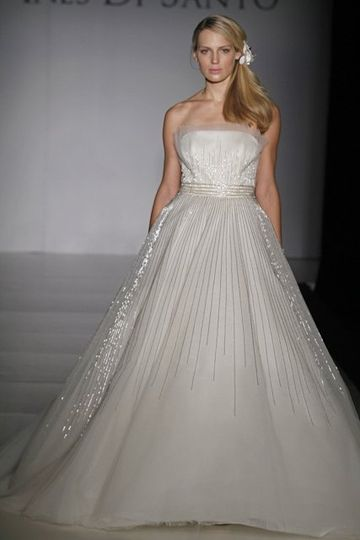 Elodie:  Strapless off white Silk Tulle ball gown with comet beading throughout skirt. Features a...