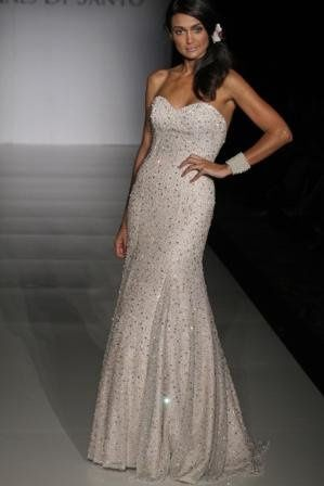 Jolie:   Strapless gown with sweetheart neckline featuring a mermaid silhouette fully beaded with...