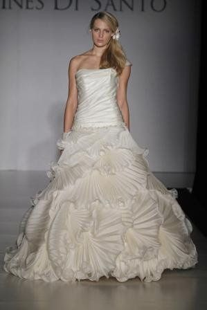 Josette:  Off white Silk Satin Organza dropped waist gown with pleated asymmetrical ruffle skirt....
