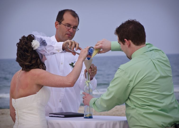 A sand ceremony is a nice addition to any wedding on the beach!  Photo by Bill Powers.