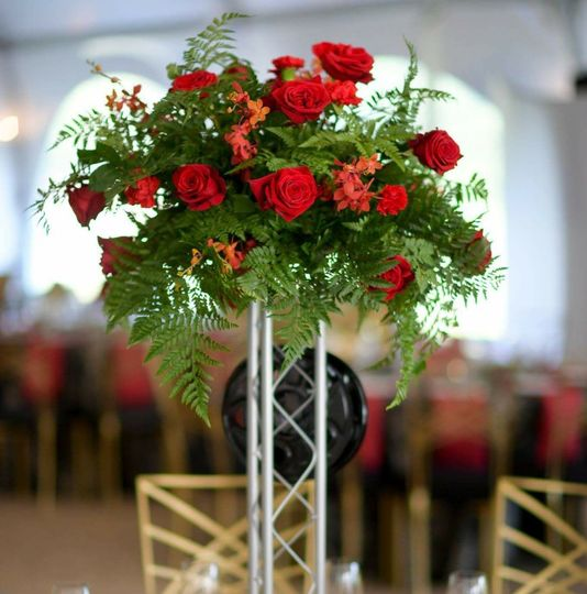 Tall wild red and green centerpiece