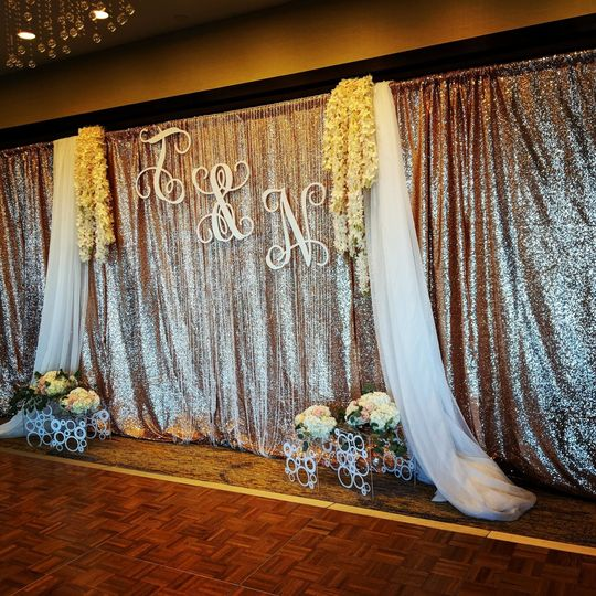 Blush sequin drape with added flowers and drape overlay