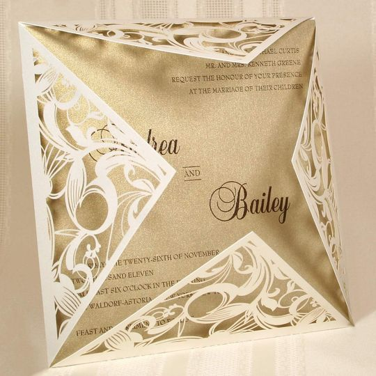 Off-White Shimmer Laser Cut Couture by Storkie Express: This gorgeous invitation features a...