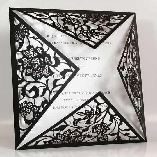 """Black Laser Cut Couture"" features a spectacular, laser-cut wrap that surrounds your insert card...."
