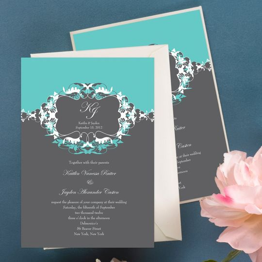 This beautiful letterpress wedding invitation features two breathtakingly ornate flowers swaying...