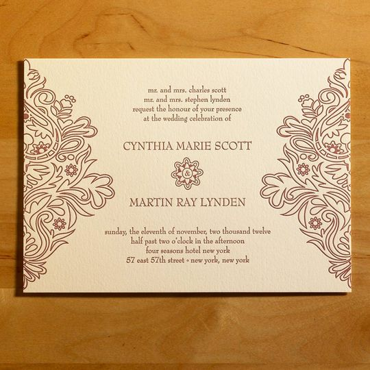 This stunning letterpress wedding invitation features bold, modern, blossom filled swirls nestled...