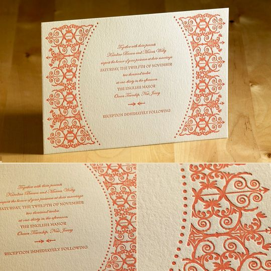 This striking letterpress wedding invitation features an ornate gate design and arches of classic...