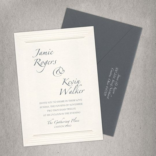 This classic, ecru-colored wedding invitation features etched multi-layered borders that completely...