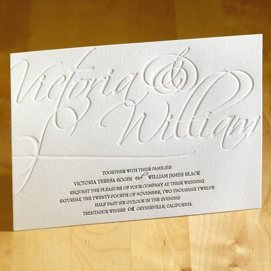 This stunning letterpress wedding invitation features your custom text as the main attraction. The...
