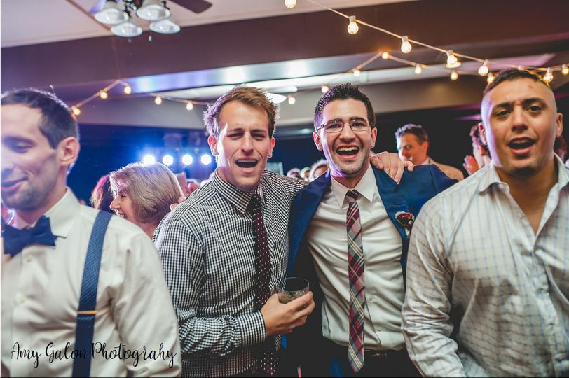 The groom and his friends dancing and singing