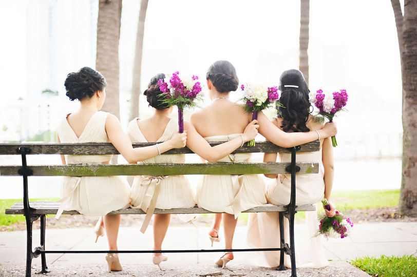 Bride and bridesmaids on a bench