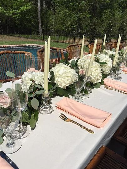 Wedding table with white roses centerpiece