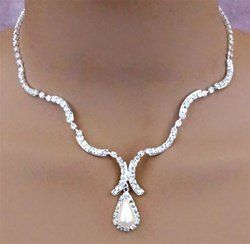 This beautiful set has a curvy 18 inch adjustable rhinestone chain with a pear-shaped white faux...