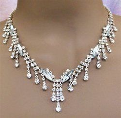 This attractive Crystal rhinestone set has a menagerie of genuine Clear Austrian Crystals on an 18...