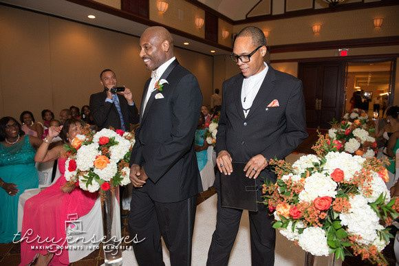 Groom and officiant during the processional