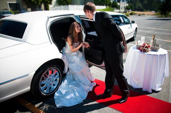 Limousines can become a great back drop for beautiful wedding photos!