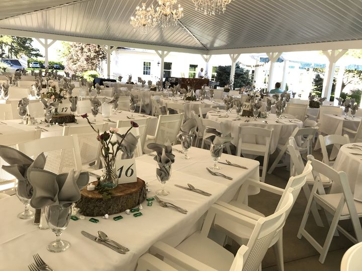 The crisp white tables and chairs