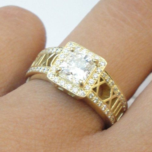 Custom design for a very special anniversary. 18K yellow gold diamond-rimmed band with a 1.2ct...