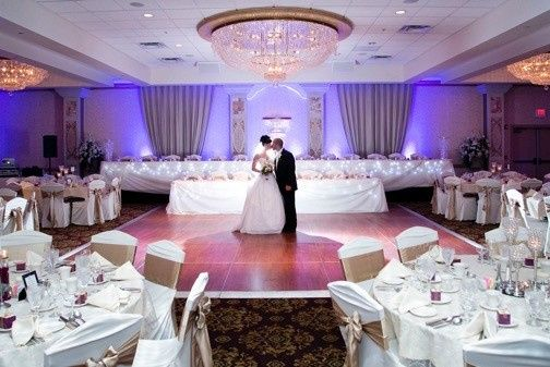 Bride and Grooms sneak peak of their ballroom before their guests. Bella Ballroom with double tiered...
