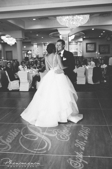 Timeless black and white photo of bride and grooms first dance in the Grand Bellamore Ballroom
